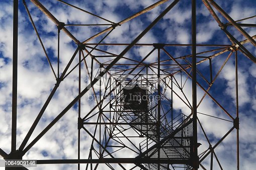 istock Bottom view tower in the sky. The construction of the tower on the background of the sky with clouds 1064909146