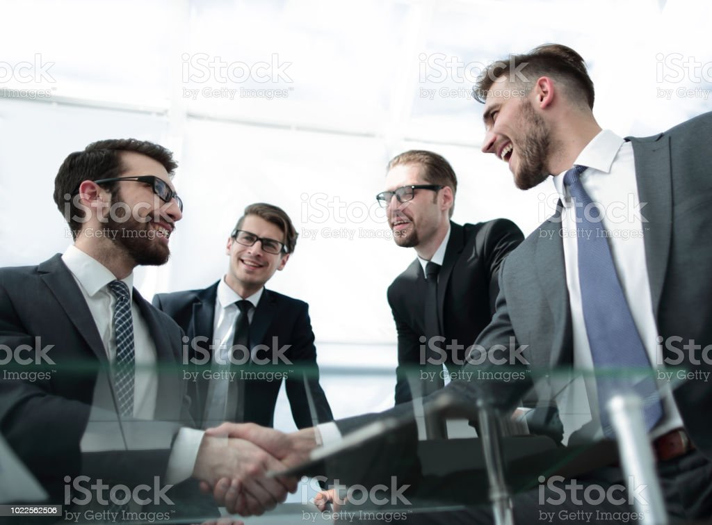 bottom view.a handshake is serious business partners stock photo