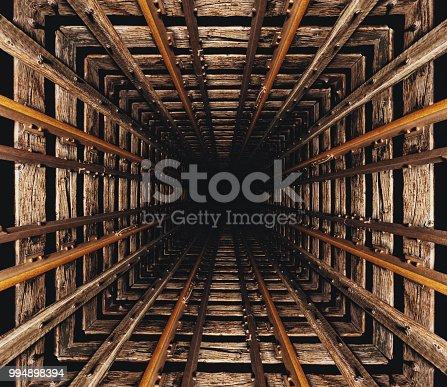 A bottomless elevator shaft/mineshaft concept.  Composite image.