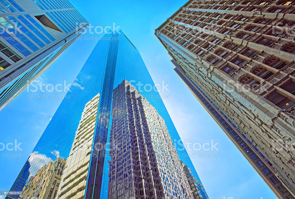 Bottom-up view of skyscrapers reflected in glass in Philadelphia stock photo
