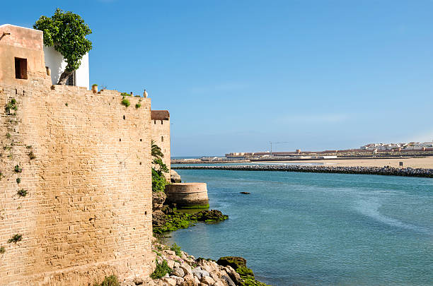 Bou Regreg River Fortified wall of the Kasbah of the Udayas in Rabat, Morocco located at the mouth of the Bou Regreg river opposite of Salé. salé morocco stock pictures, royalty-free photos & images