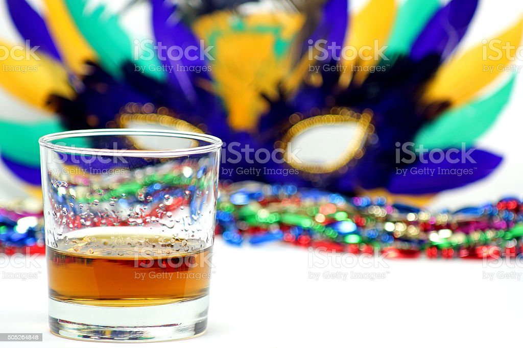 Boubon Glass in front of Feather Mask stock photo