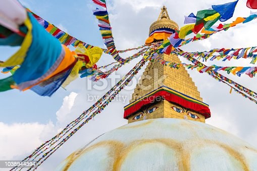 Boudhanath Stupa and prayer flags in Kathmandu, Nepal. Buddhist stupa of Boudha Stupa is one of the largest stupas in the world