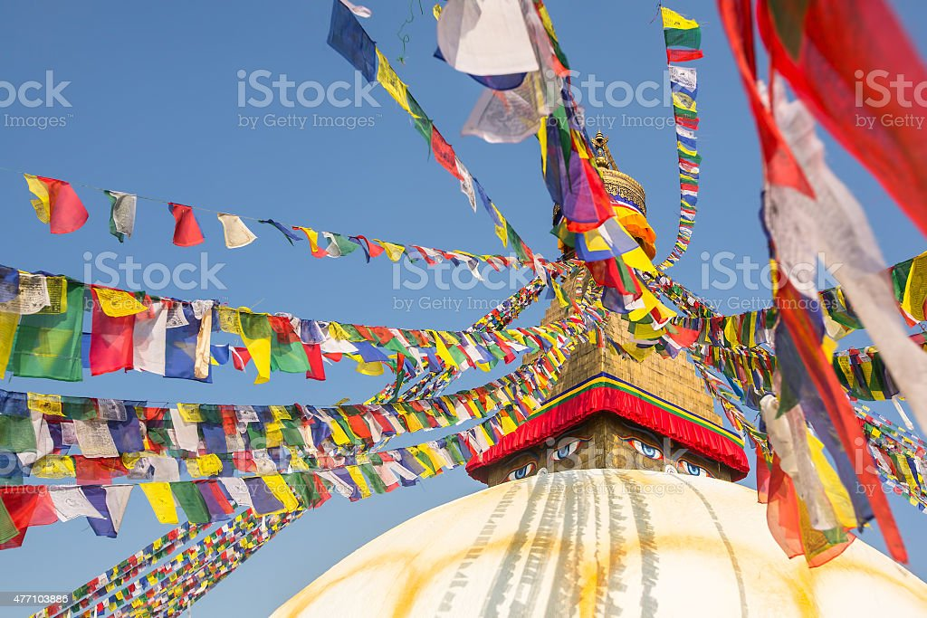 Boudhanath stupa - symbol of Nepal, with colorful prayer flags. stock photo