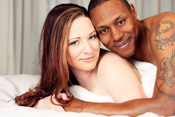 Boudoir portrait of a bi-racial couple Boudoir portrait of a bi-racial couple. You might also be interested in these: real couples making love stock pictures, royalty-free photos & images