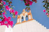 Bougainvillea and Greek orthodox church, Santorini