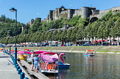 Bouillon, Belgium - August 13, 2016: Bouillon with castle and river Semois with pedalos for recreation