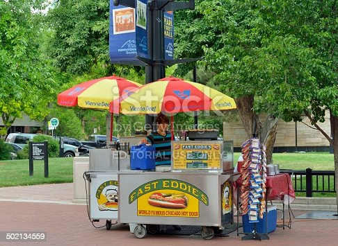 Boulder, Colorado, USA - June 16, 2013: A hot dog vendor in downtown Boulder, Colorado. Located at the foot of the Rocky Mountains, Boulder is a college town with a vibrant night life and active community with a bohemian flair.