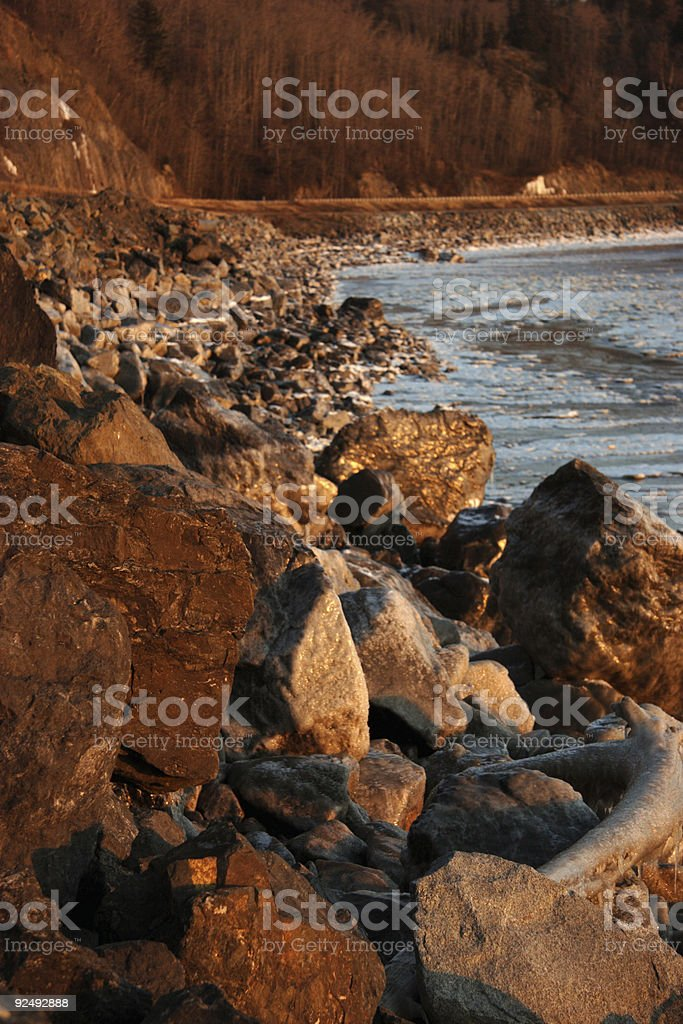 boulder covered coastline royalty-free stock photo