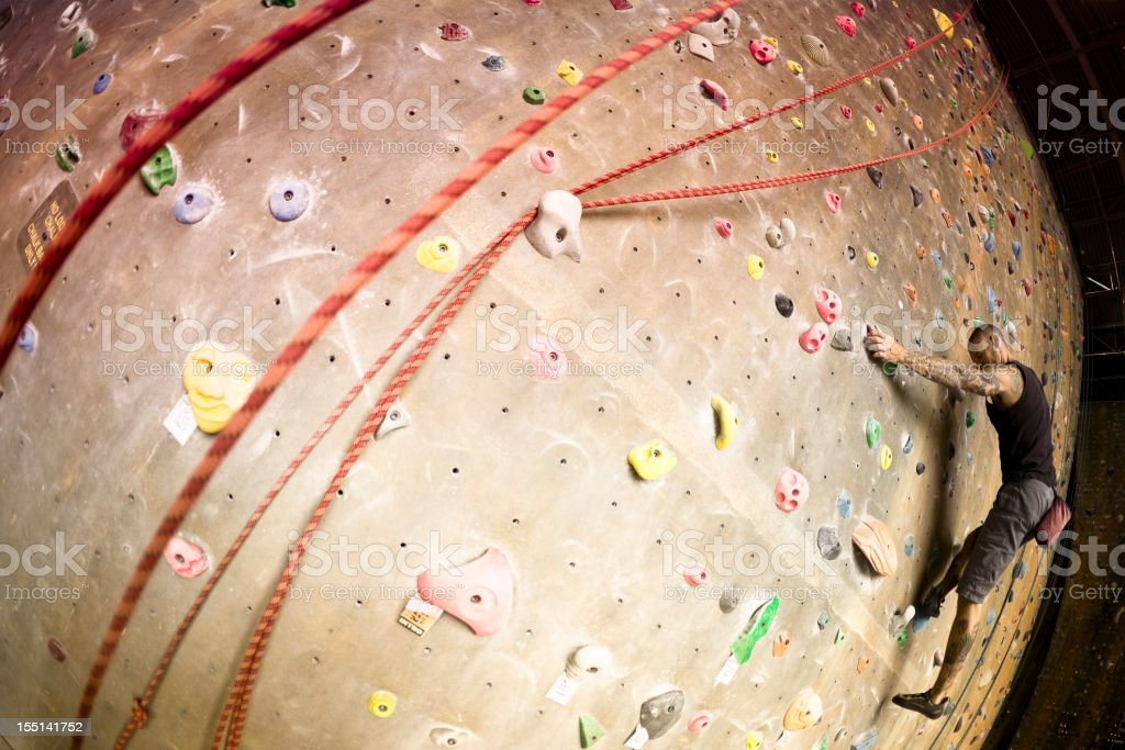 Bouldering on the  Rock Climbing Wall royalty-free stock photo