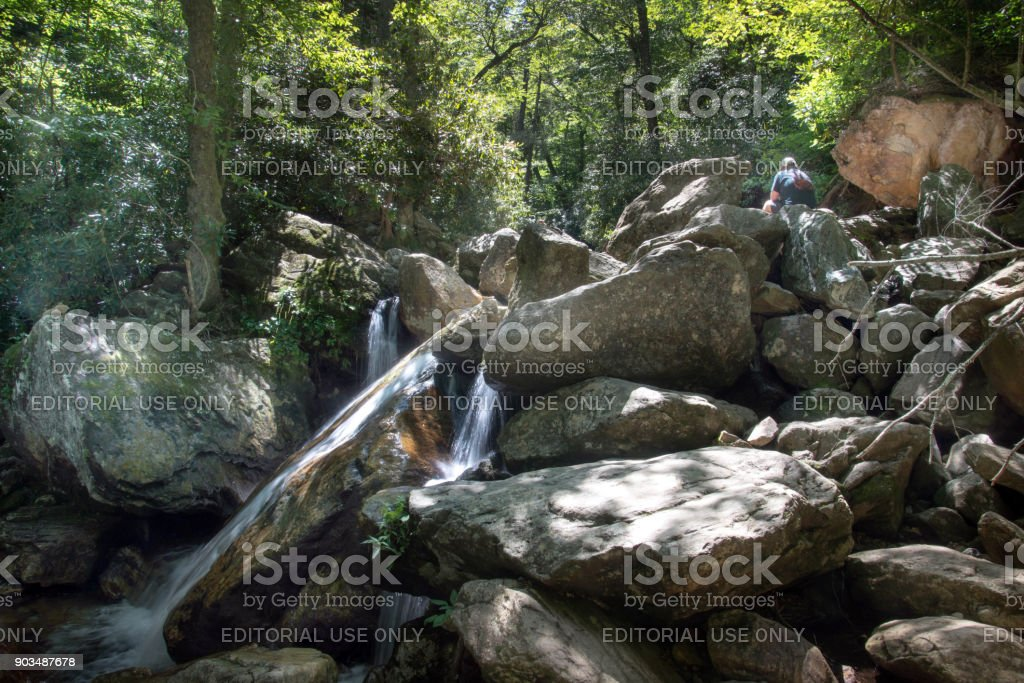 Boulders and water flowing between stock photo