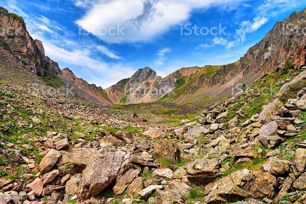 Boulders at top of small mountain valley stock photo