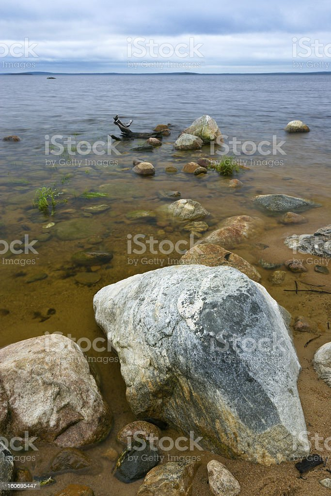 Boulders on a lake stock photo