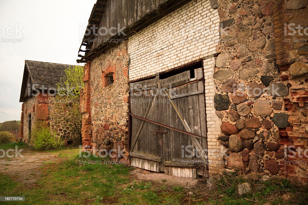 Boulder's wall of Old ruined building stock photo