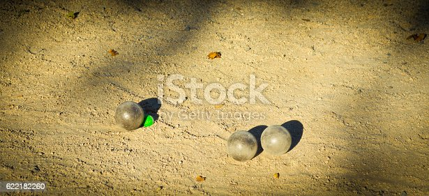 Boule balls on a boule court in Vallon Pont D'Arc, France.