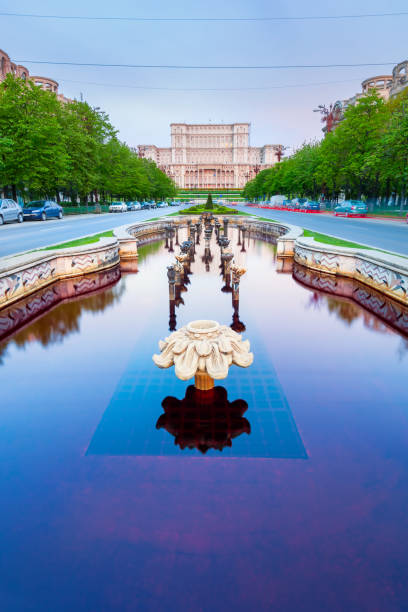 Boulevard and fountain at the Parliament Building in Bucharest Romania stock photo