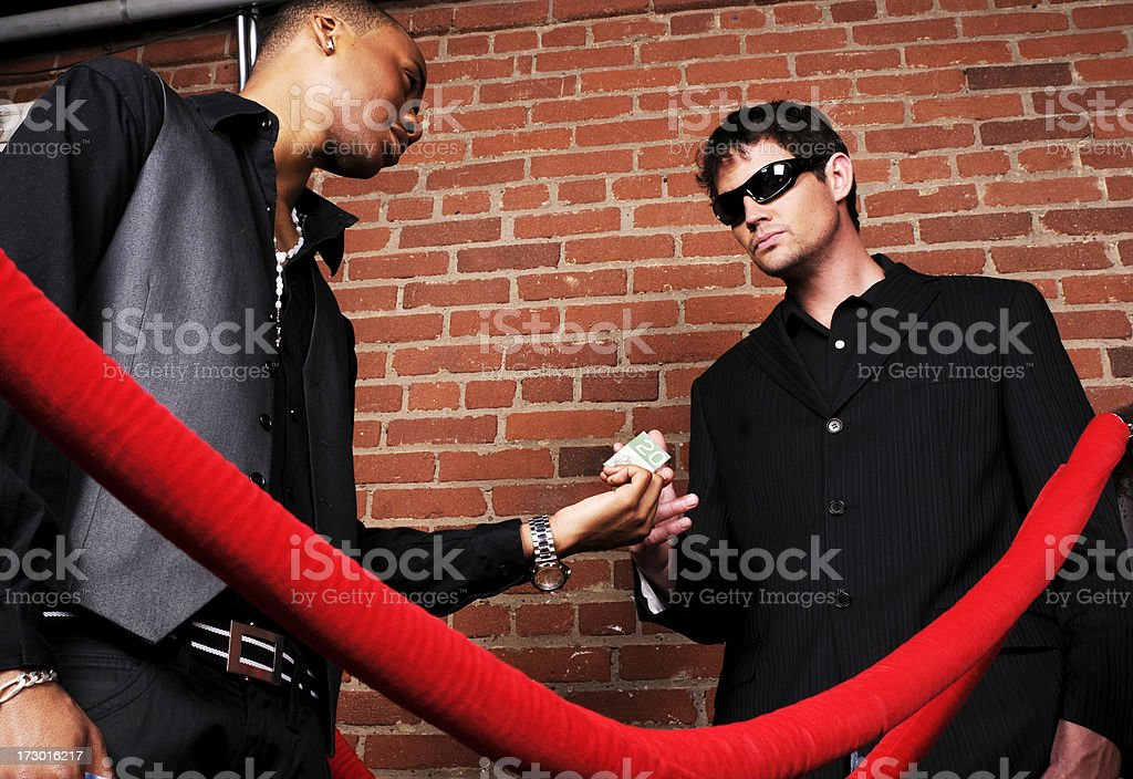 Bouncer Bribery stock photo