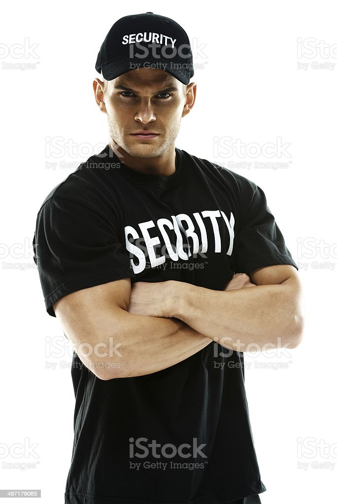 Bouncer standing with arms crossed stock photo