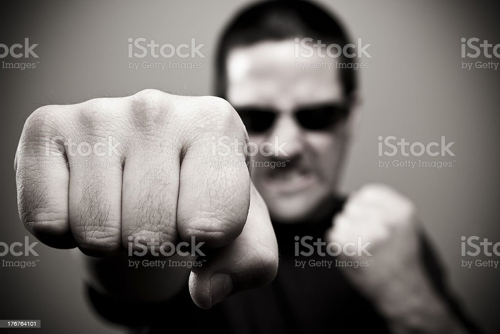 Bouncer throws a punch royalty-free stock photo