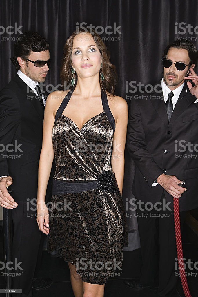 Bouncers admiring attractive woman stock photo