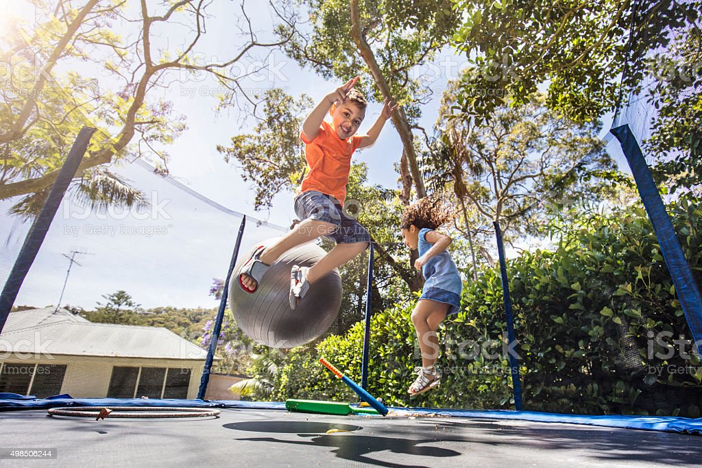 Bouncing on the trampoline stock photo
