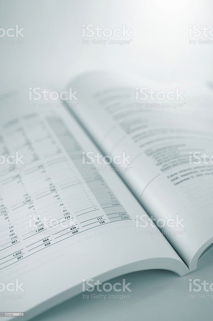 A bound financial report opened on white background. royalty-free stock photo