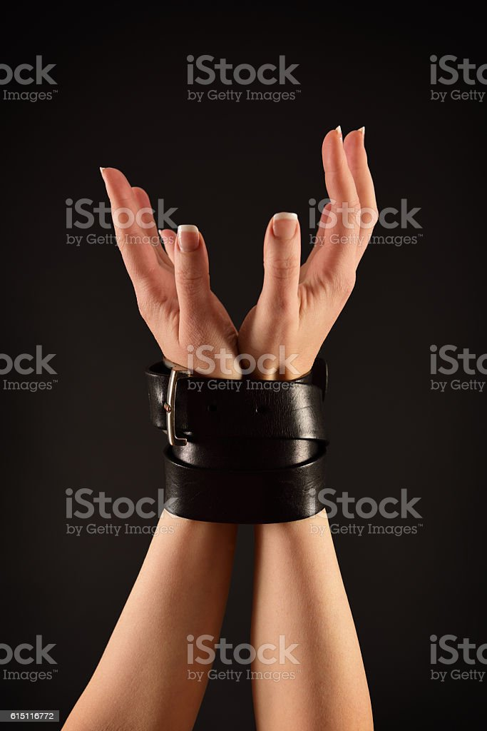 Bound hands of a woman stock photo