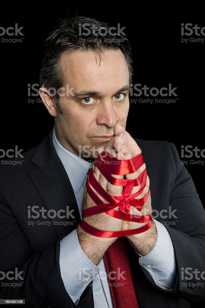 Bound up in red tape royalty-free stock photo