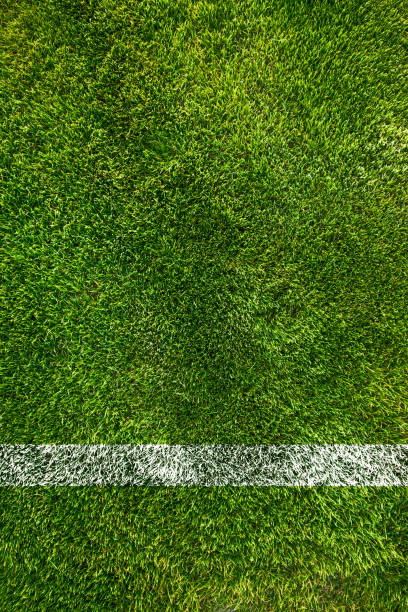 A boundary line on a soccer field stock photo