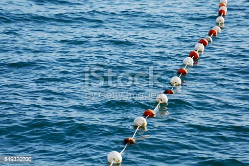 Boundary marks float on sea water's surface