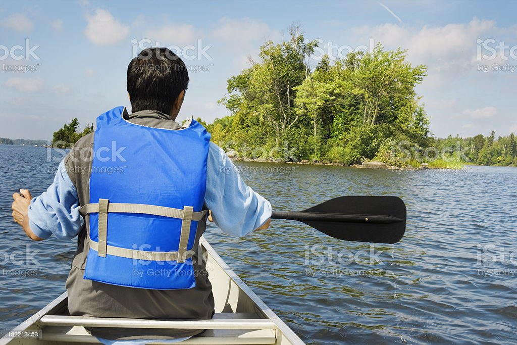 Boundary Waters Canoe Area Canoeing Man with Life VestHz royalty-free stock photo