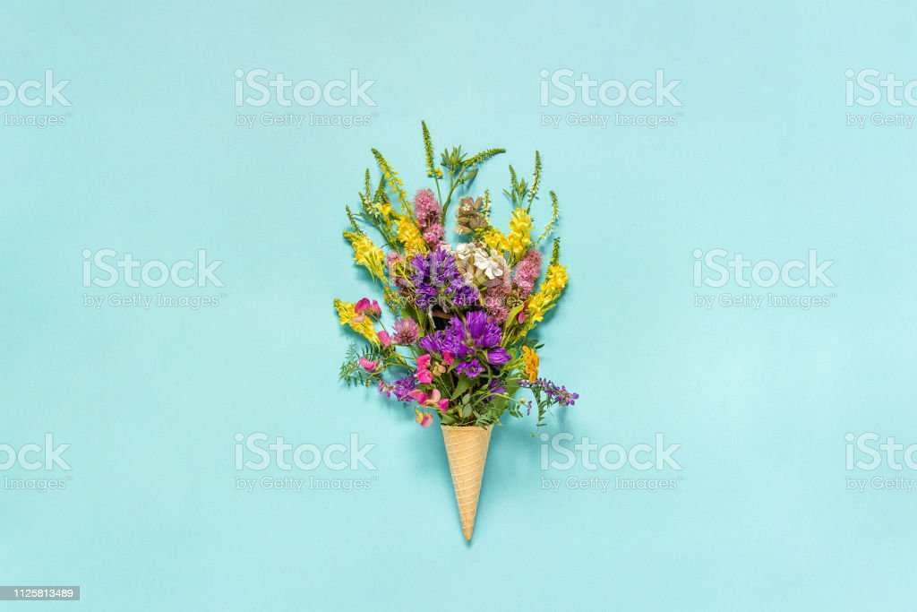 Bouquet Field Colored Flowers In Waffle Ice Cream Cone On Blue Paper Background Creative Flat Lay Top View Mock Up Concept Womens Day Or Mothers Day Hello Summer Stock Photo Download