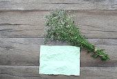 istock Bouquet flower grass and wrinkled green paper on a brown wooden background. 694719456