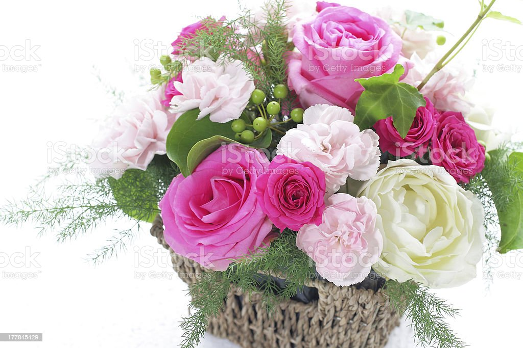 Bouquet from different pink seasonal flowers in basket royalty-free stock photo