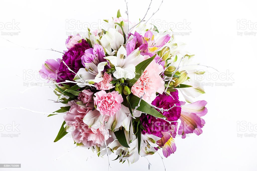 Bouquet from pink and purple gillyflowers and alstroemeria on wh stock photo