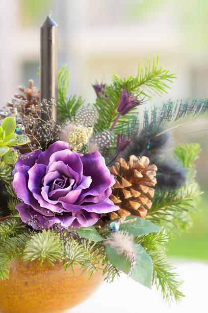bouquet has christmas tree branches and artificial flowers. - weihnachtsspende stock-fotos und bilder