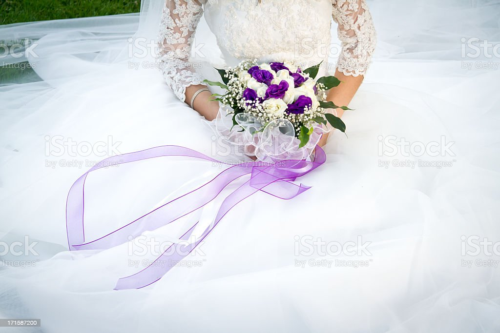 Bouquet in hands of the Bride stock photo