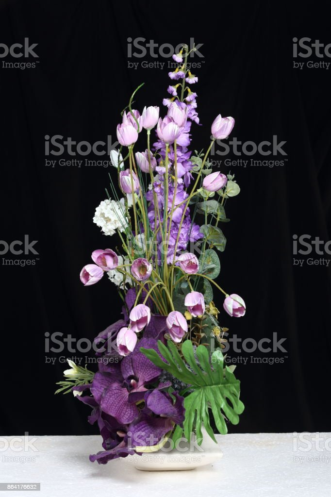 Bouquet of Artificial Flower Colorful, Black background white table royalty-free stock photo