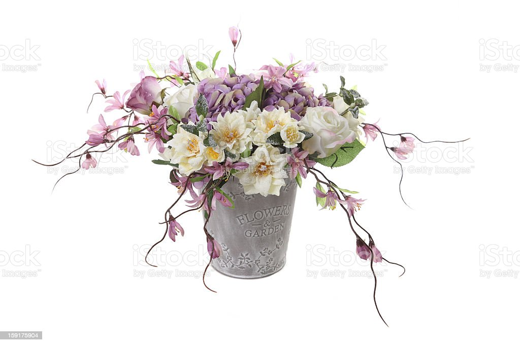 bouquet of artificial flowers in a decorative bucket royalty-free stock photo