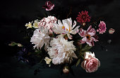 istock Bouquet of beautiful garden flowers on black background. Vintage floral card. 1217573504