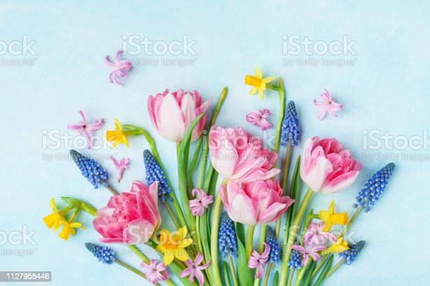 Bouquet of beautiful spring flowers on pastel blue table top view picture id1127958446?b=1&k=6&m=1127958446&s=612x612&h=ruzhd0sj306utokw1yhjw9ffnrj8tuhguxrd2xkdzek=