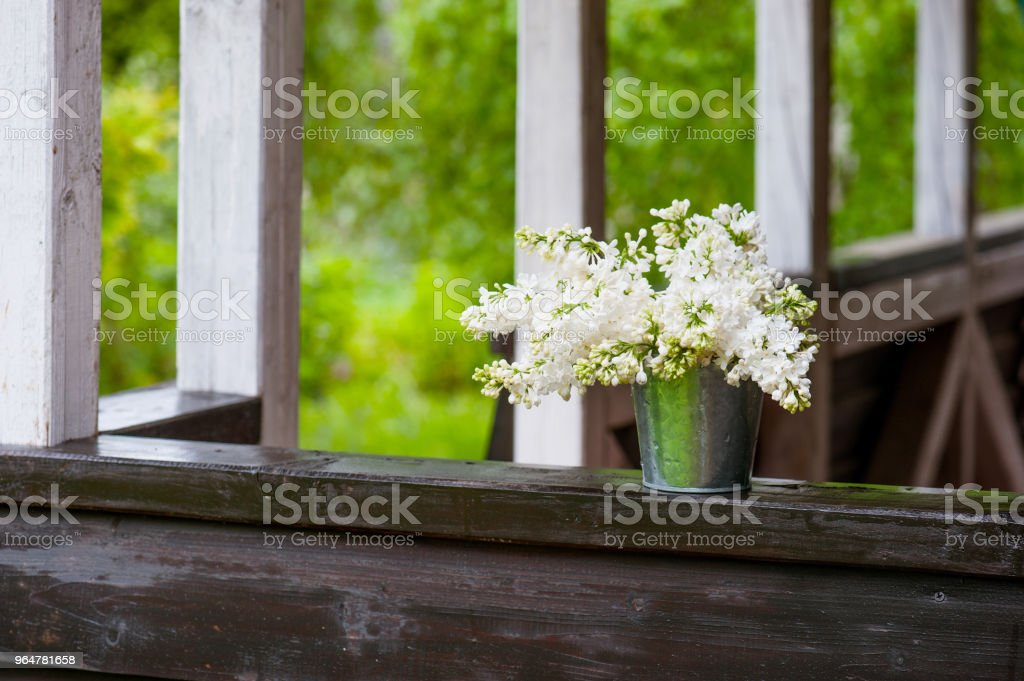 Bouquet of blooming white lilac on the terrace royalty-free stock photo