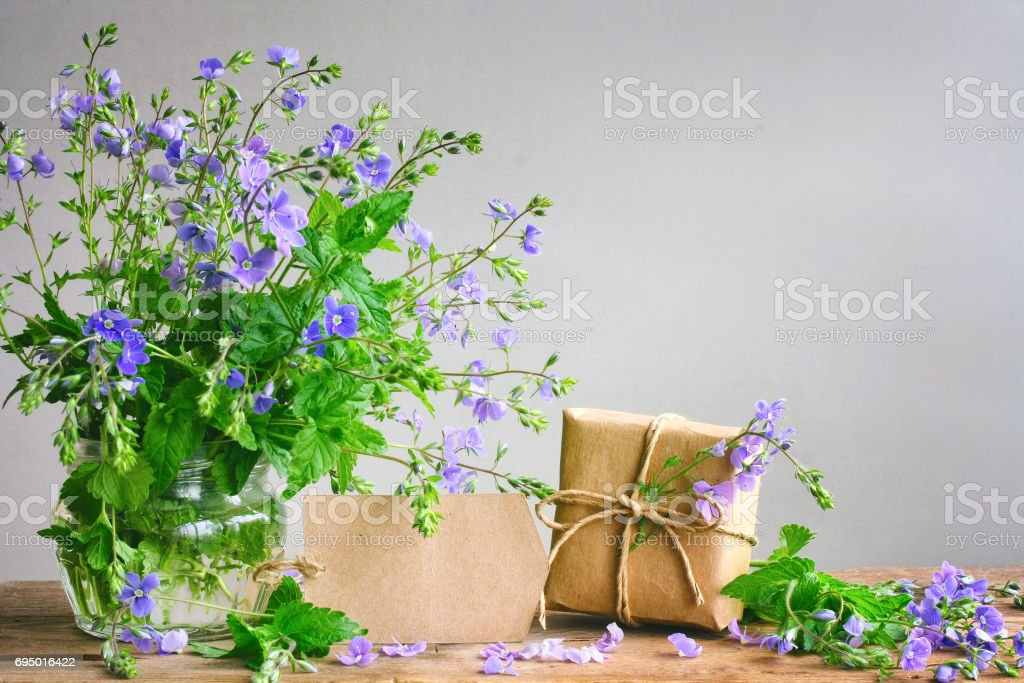 Bouquet Of Blue Flowers Veronica Persian In Glass Vase Gift Box Royalty Free