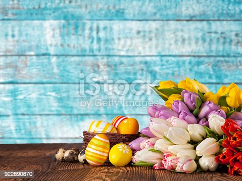 istock Bouquet of colored tulips with Easter eggs 922890870