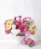 Bouquet of colorful chrysanthemums  on old white wooden board.