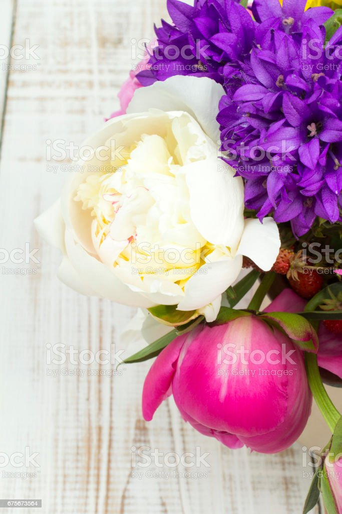 bouquet of colorful flowers on white wooden planks royalty-free stock photo