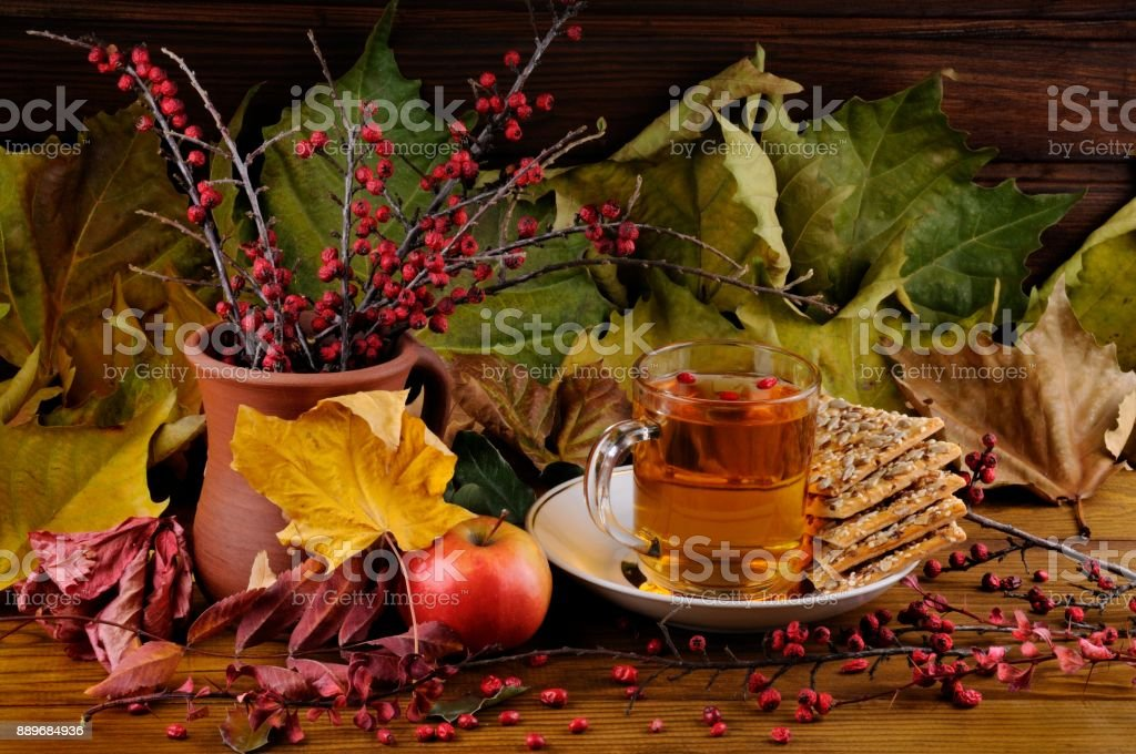Bouquet of Cotoneaster and Tea Mug with Apple stock photo