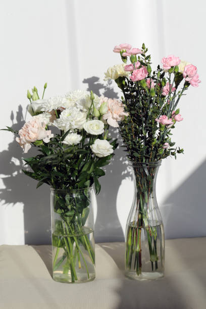 Bouquet of Cute White and Pastel Pink Dianthus, Chrysanthemum and Rose Flowers stock photo