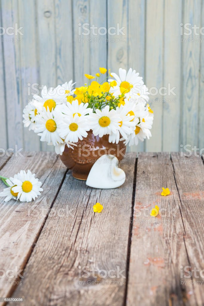 Bouquet of daisies and buttercups. Vintage romantic floral background. royalty-free stock photo