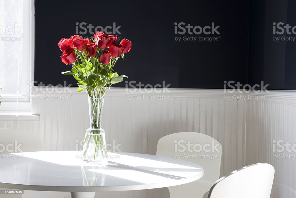 Bouquet of Dozen Red Roses on Breakfast Table, Copy Space royalty-free stock photo